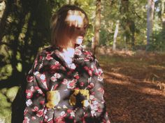 Lost in New Forest - a miniature oriental world - photo shooting in New Forest, London featuring slow fashion designer YUAN. Get the Red flower embellished coat from the designers' autumn winter collection. | On Slowness blog