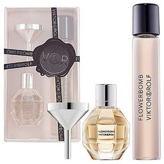 Viktor & Rolf Refillable Travel Duo | Wondering what travel gifts to buy your friends and family? Travel Fashion Girl's writers have pooled together the items on their wishlist. Take a look! You'll definitely want to add some to your list, too! | travelfashiongirl.com