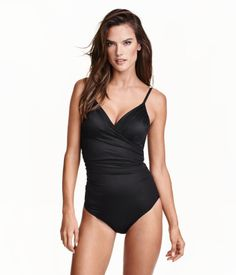 Fully lined shaping swimsuit with sculpting effect on stomach, back and seat. Wrapover top section with lightly padded cups and boning. Decorative gathers at sides and adjustable shoulder straps. | H&M Swim