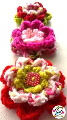 Colorful Blossom   I designed this flower to show a fun way to choose colors when making things such as granny squares and afghans. It is worked in one continuous piece, not sewn together. The last round could be left off to create a smaller blossom. Flowers are beautiful clipped on bags, hats, h