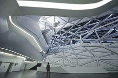 The main foyer of Zaha Hadid's Guangzhou Opera Houseshowing its eye-boggling spider's web structure to suitably operatic effect. #architecture