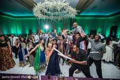 Indian couple and guests dancing at wedding reception http://www.maharaniweddings.com/gallery/photo/105363 @indaglowprod