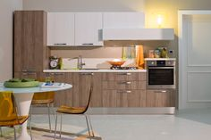 Start off on the right foot by giving your kitchen the youthful feel of a design with pure lines dressed in cool colors and wood finishes that are in step today's trendy natural look. Home Decor Kitchen, Kitchen Design, Laundry Room Remodel, Cuisines Design, Catalogue, Kitchen Cabinets, Interior Design, Cool Stuff, Wood