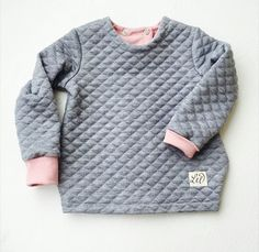The product GRAY QUILT OPEN SWEATER is sold by P E T I T   PUK in our Tictail store.  Tictail lets you create a beautiful online store for free - tictail.com