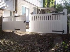 Making A Grand Entrance on Your Home with Driveway Gate Designs Wood Concept: Breathtaking White Paint Wooden Driveway Gate Designs Perfect Looks ~ boholmain.com Doors Inspiration