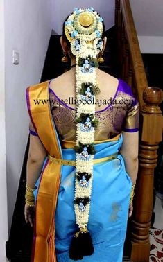 Doll poolajada with peacock feathers for bride wearing blue kanjeevaram saree Beautiful Hairstyles, Easy Hairstyles, Wedding Hairstyles, Baby Shower Hair Styles, Indian Flowers, Hair Upstyles, Bridal Hairdo, Hindu Bride, Hair Decorations