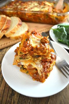 Beef, Spinach, & Mushroom Lasagna - One of the most popular recipes on my blog. This lasagna recipe is full of fresh and healthy ingredients including: brown rice pasta noodles, grass-fed beef, and fresh mushrooms, garlic, and onions. It will become your go-to lasagna recipe! | twothirdscup.com