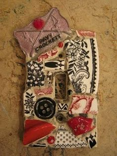 Mosaic switch plate with Davey Crocket pin by Kelly Aaron