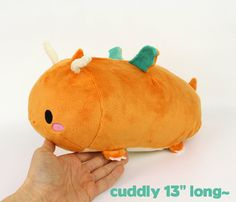 Sew kawaii, cuddly 13 dragon roll plush with this DIY plushie sewing pattern and photo tutorial! Learn how to make your own kawaii high quality