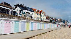 Pastel beach huts in Lyme Regis