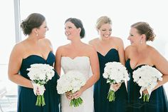 white wedding bouquets for the bride and bridesmaids.