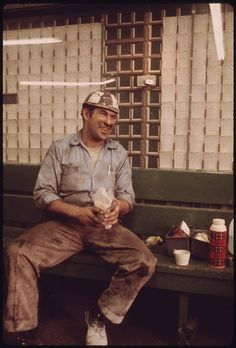 Original Caption: Miner Spreads His Lunch Out on a Bench in the Shower and Time Card Room of the Virginia-Pocahontas Coal Company Mine #3 near Richlands, Virginia. He Hauls Equipments Into the Mine During His Work Shift 04/1974    U.S. National Archives' Local Identifier: 412-DA-13864    Photographer: Corn, Jack, 1929-    Subjects:  Richlands (Tazewell county, Virginia, United States) inhabited place  Environmental Protection Agency  Project DOCUMERICA    Persistent URL: http://arcweb.archives.gov/arc/action/ExternalIdSearch?id=556316