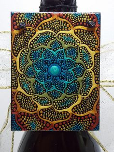 Holiday Special!! Artful Ornaments ~ 3x4 inch hanging Mini Painting on wood This Flower of life dot painting is painted with metallic acrylic paints that really shine. Painted on wood block. Black hemp string is attached for easy hanging or displaying. Many dots make up this painting
