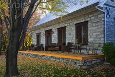 Old Canadiana (circa 1750) cottage style fieldstone Residential Home in autumn, Quebec, Canada.