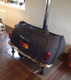 The back of a car made into a wood burning stove?