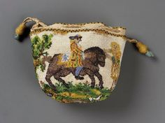 1700-1725 French Round drawstring bag. Polychrome opaque and translucent glass beads (sablé) strung with linen thread, held together by interlocking looping stitches. Polychrome design on white ground: boy on horse with fleur-de-lis on saddle, girl right; woman picking fruit, dogs, birds, insects surround. Yellow and black bead binding at top. Ecru silk braided cord drawstring with two yellow bead-covered wood tassels. Salmon silk taffeta lining.