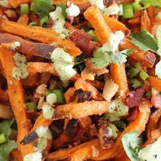 Sweet or salty?! We're thinking a little bit of both tonight! These sweet potato fries with bacon and cilantro lime sauce have us licking our lips! The sweetness of the fries mix deliciously with the salty smokey bacon, plus add the tangy cilantro sauce for a  fresh effect! Get your ovens ready because you can find this recipe at BestFriendsForFrosting.com! #food #sweet #salty #frenchfries #snack