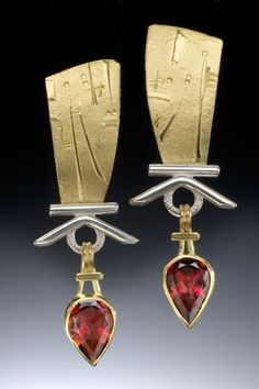 Ruby, 14K gold, and white gold earrings.