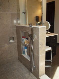 Put storage niches on the shower side of the half wall so clutter is not visible.