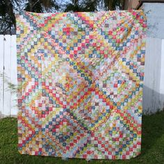 Scrappy Trip Around the World Quilt by Janice at Better Off Thread - oh boy - gotta try this, looks easy and fun!