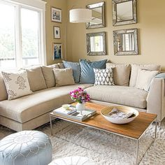 Love the beige sectional and pillows. I would add more colorful bright pillows to tie in the wall colors of my family room