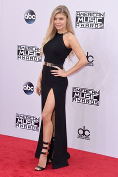 Singer Fergie shows off those legs in a gorgeous black gown with a gold belt and strappy heels. via @stylelist