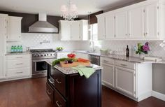 One of my favorite kitchens I followed while remodeling my own kitchen.  Love the beveled arabesque tile and the dark paint.