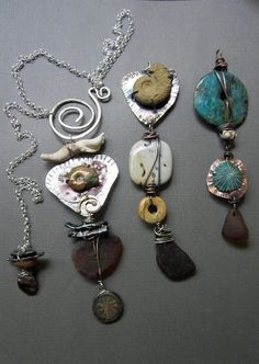 Staci Smith/stacilouise - Tribal Sea Glass Pendants - sea glass and fossil assemblages are huge and chunky pendants, that can be switched on and off, and are adjustable on these swirl clasp chains