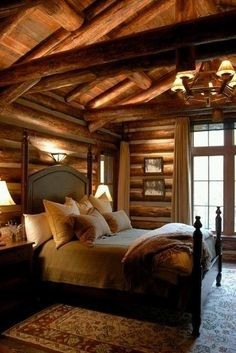 Lovely Log House . Cozy and warm bedroom .