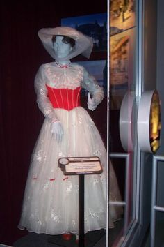 """Julie Andrews """"Mary Poppins"""" garden party white gown & hat from the section with animated characters"""