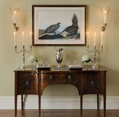 Sideboard, silver, sconces - dining room in a horse country home - Crisp Architects, photo by Rob Karosis
