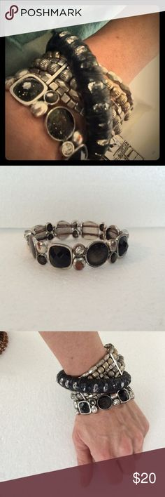 Black and Silver Bracelet Beautiful!  Wear singularly or layered with your other favorite bangles.  Some fading in small areas-adds to vintage look. Jewelry Bracelets