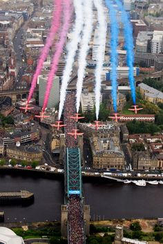 The Royal Air Force Red Arrows flypast over the Tyne Bridge for the start of the Great North Run in Newcastle 2012