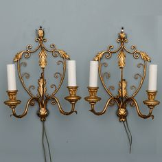 Pair French  Delicate Gilt Metal Two Light Sconces  --  Circa 1930s pair of metal two light sconces with gilded finish, shield shape, open work back plate with acanthus leaves and decorative scrolls, two arms with giltwood bobeches and candle form lights and new wiring for US electrical standards.  --   Item:  3642  --  Retail Price:  $995