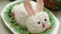 Remember old-fashioned cutout cakes? This cute bunny is easily madefrom carrot cake mix frosted and covered with mouthwatering coconut.