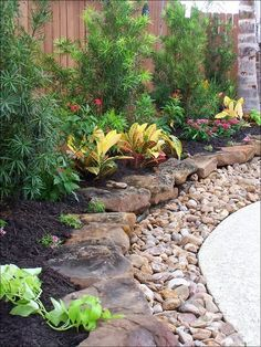 Layered rock border. I love this. It's natural looking and if you live where I do rocks are everywhere and free.