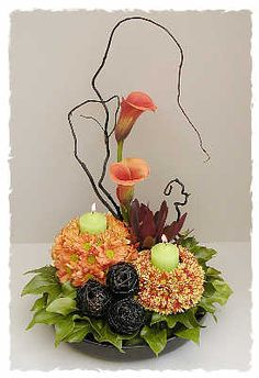 TWO BALLS WITH CHRYSANTHS IN BURNT ORANGE CALLA LILLIES ORANGE AND RED LILLIES