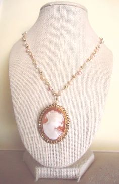 Something old plus something new!  This charming retro necklace features a handmade linked chain, with 14k gold-filled twist beads and natural pink / white freshwater pearls, crowned by a stunning, vintage Van Dell cameo pendant brooch (likely from the '50s), hand-carved from pink-orange carnelian shell and sporting a detailed bas-relief profile of a woman. A great idea for a wedding gift (something old) or 50th anniversary (golden anniversary) present for someone who collects cameos :)…