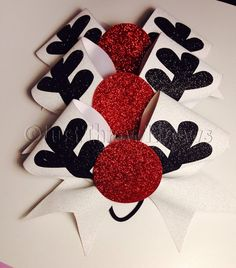 Big Glitter Rudolph Cheer Bow. White glitter base with black antlers and a big red glitter nose! This is a great bow! Perfect for a themed practice