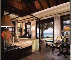 Bedrooms at the bird of paradise villa in anguilla. Suite #1 bedroom with view of verandah, plunge pool, and Caribbean Sea
