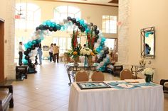 Guests view as they sign in. Balloon arch with school colors.