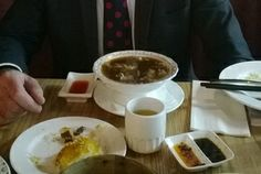 Edward Rooney with shark fin soup at the Jade Dragon restaurant.