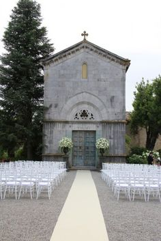 Tuscan Wedding outdoor ceremony in front of the little church...lovely