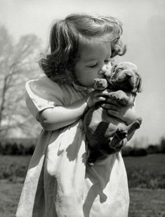 15 Heartwarming Vintage Pictures of People with Their Dogs