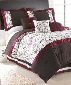 I love this comforter set! Not good idea with the pups though. :(