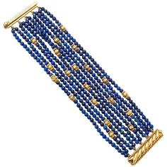 This striking Verdura bracelet is designed with ten strands of lapis beads that are studded with yellow gold rondels and a clasp featuring 2 rows of rope-patterned yellow gold, signed Verdura. Gold Jewelry, Fine Jewelry, Jewelry Art, Ruby Jewelry, Bijoux Lapis Lazuli, Art Nouveau Jewelry, Beaded Jewelry Patterns, Bijoux Diy, Schmuck Design