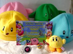 Calling all gamers! Cute Kirby theme for a child's birthday party. Invite from Pogo Parties (https://www.etsy.com/shop/PogoParties) and hat favors by Fishing for Birdies (https://www.etsy.com/shop/FishingForBirdies). Party Design by B. Lee Events in New York City