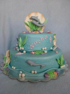 Dolphin cake with plenty of room for frogs