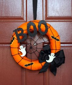 Orange Boo Wreath | Welcome trick-or-treaters (and enhance your curb appeal) with these stylish wreaths.