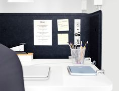 BEKANT black screen attached to the desk and used as a notice board